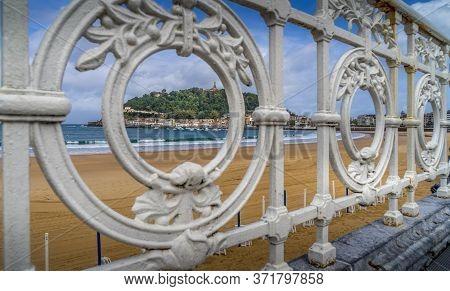 View Of Concha Beach In San Sebastian Through The Famous Iron Fence