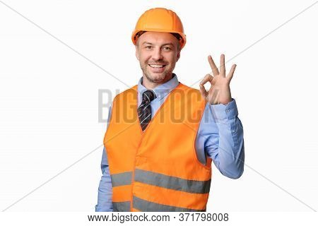 Building Is Okay. Construction Site Worker Gesturing Ok Posing Over White Studio Background, Smiling