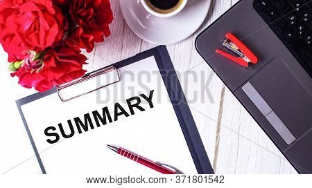 Summary Written On A White Background Near Red Roses, A Notebook And Pen
