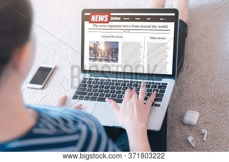 Woman Reading News On A Laptop Screen. Mockup Website. Newspaper And Portal On Internet.