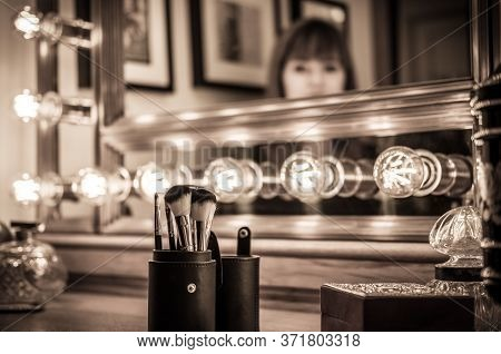 Vintage Vanity Makeup Accessories, Makeup Dressing Table With Undefined Woman At Mirror