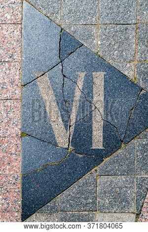 Sign On The Cobblestones In The Form Of A Roman Numeral Six. Street Paving. Cobblestone Pavement. Ba
