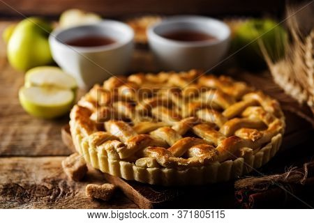 Apple Pie With Fresh Apple Slices In A Plate