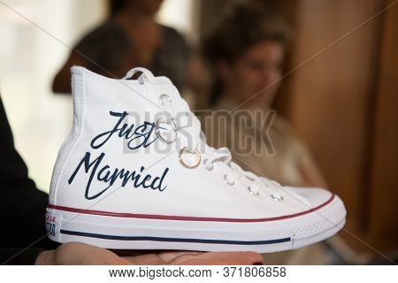 Bordeaux , Aquitaine / France - 01 15 2020 : Bride Wedding Rings In Just Married White Sneakers Conv