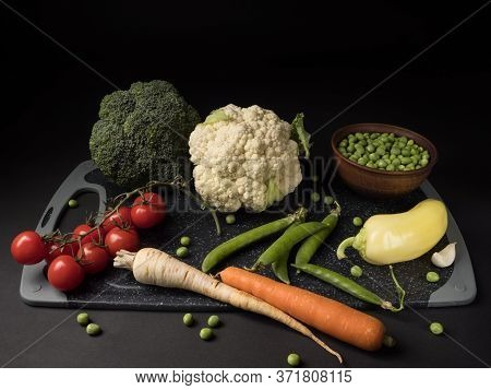 Set Of Vegetables For Vegetable Soup On A Cutting Board.