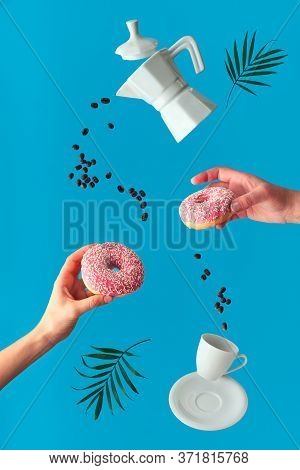 Trendy Levitation. Flying Ceramic Coffee Maker And Espresso Cup With Saucer. Two Female Hands Hold P