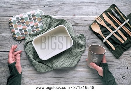 Creative Flat Lay, Zero Waste Lunch Concept With Set Of Reusable Wooden Cutlery, Lunch Box, Drinking