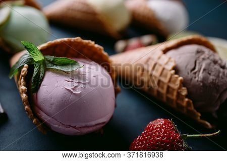 Ice-cream Texture. Flavored Homemade Ice Cream Scoops In Waffle Cones, Close Up. Food, Summer Refres