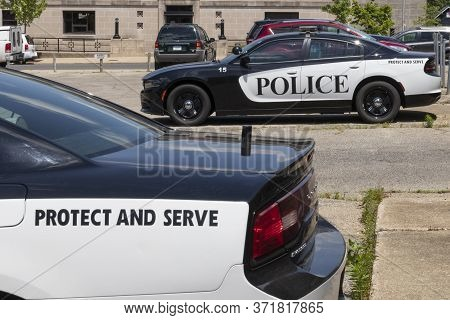 Logansport - Circa June 2020: Police Cars With The Words Protect And Serve. Actions By The Police Ha