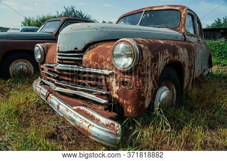 Old Retro Rusty Abandoned And Forgotten Cars, Cemetery Of Vintage Autos.