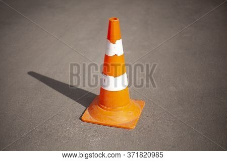 The Cap Is Orange. Road Sign Fencing Path. Means For Warning People About An Obstacle On The Highway