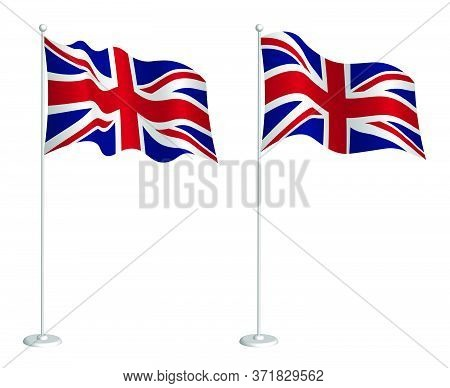 Flag Of United Kingdom Of Great Britain And Northern Ireland On Flagpole Waving In The Wind. Holiday