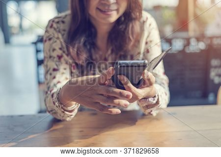Asian Woman Using Smartphone Shopping Online Website On Smartphone With Smiling Face. Happiness Asia