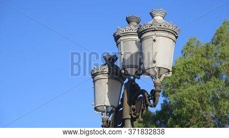 View Of Village Street Light Against Blue Sky