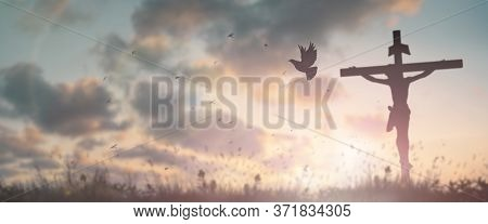 Silhouette Jesus Christ Crucifix On Cross On Calvary Sunset Background Concept For Good Friday He Is