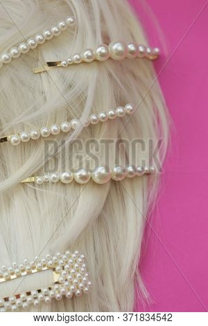 Pearl Hair Clips On Blond Hair Close-up. Fashionable Hair Accessories. Hairpin With Pearls On A Brig