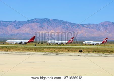 June 10, 2020 In Mojave, Ca:  Row Of Retired Qantas Airlines 747 Aircraft Ready To Be Resold Or Dism