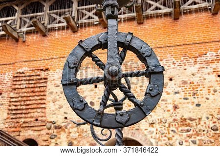 Forged Wheel In The Old Forge In The Theme Park, Mir Castle. Belarus