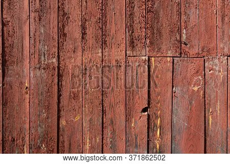 Wooden Texture Of Red Color Background. Stock Photo Of Rustic Wooden Textured Wall