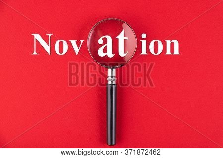 Novation Text Written Through A Magnifying Glass On A Red Background. Business Education Concept.