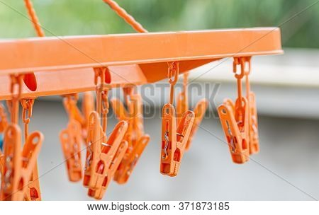 Orange Color Plastic Clothespins On The Hangers, Clothespins On The Hangers For Wash Clothes.