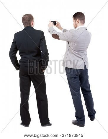 Back view of  two business man in suit with mobile phone. Business team. view people collection. backside view of person. Isolated over white background.
