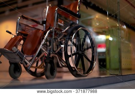 Blurred Empty Wheelchair Near Lift In Private Hospital For Service Patient And Disabled People. Medi