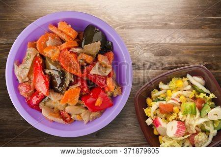 Vegetable Stew On Brown Wooden Background. Stew In Bulgarian On Purple Plate With Vegetarian Salad T