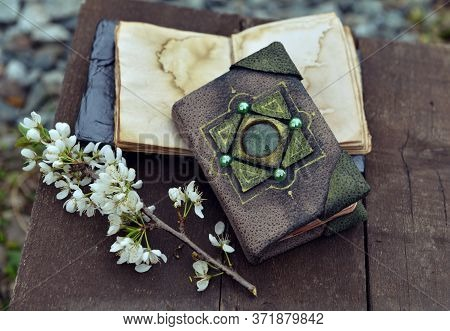 Decorated Book And Open Diary With Flowers On Planks Outdoors. Esoteric, Gothic And Occult Backgroun
