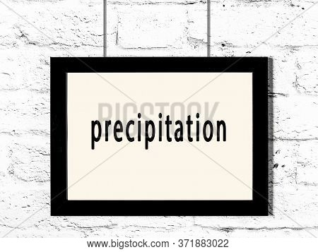 Black Wooden Frame With Inscription Precipitation Hanging On White Brick Wall