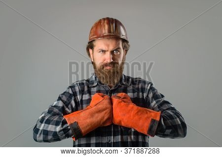 Bearded Workman In Work Gloves Hold Spade. Builder Work. Building, Industry, Technology. Builder In
