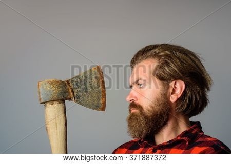 Man With Old Ax. Bearded Lumberjack. Bearded Man With Ax Beside Face. Close Up Portrait Of Man With