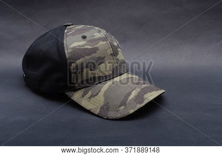 Men's Two-tone Cap On A Black Background. The Baseball Cap Is Black At The Back, Front And Visor Of