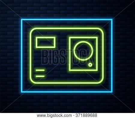 Glowing Neon Line Action Extreme Camera Icon Isolated On Brick Wall Background. Video Camera Equipme