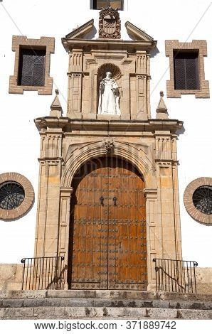 Religious Sculpture Above The Door On The Front Of The Merced Church Built In 1585, Ronda, Malaga Pr