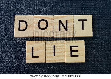 Phrase On Dont Lie From Gray Wooden Letters On A Black Background
