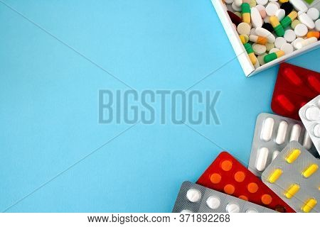 Colorful Tablets And Capsules In A White Box, Tablets In A Package, Are Located Around The Perimeter