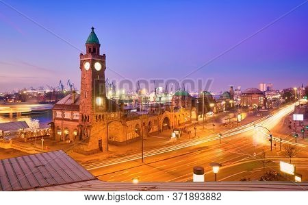 Illuminated St. Pauli Piers In Hamburg, The Floating Piers At Hamburg Harbor. Empty Streets At Dawn,