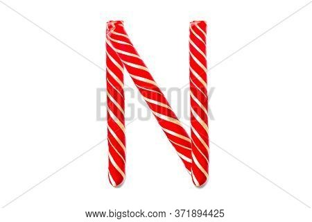 Christmas Candy Cane In The Form Of Letter N. Letter N Made Of Red Candy Cane Isolated On White Back