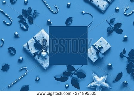 Festive Monochrome Blue Christmas Background With Gift Boxes, Stripy Candy Canes, Trinkets And Decor