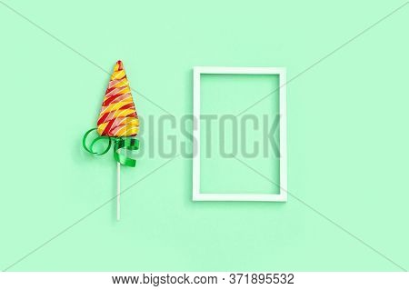 Lollipop Shaped Like Christmas Tree. Creative  New Year Flat Lay With Sweet Candy Lollypop  With Str