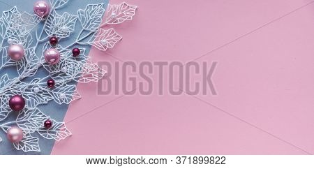 White Winter Twigs With Shiny Geometric Leaves And Scattered Glass Xmas Trinkets, Pink And Magenta.