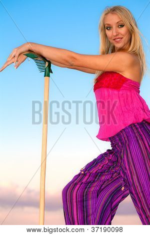 Smiling pretty blonde girl gardener
