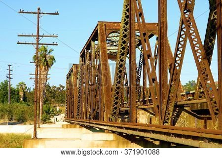 Historical Railroad Bridge With Rusty Trestles Built During 1901 Taken At The San Gabriel River Brid