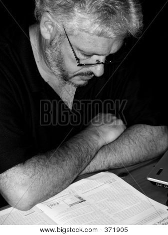 Man In Glasses Reading