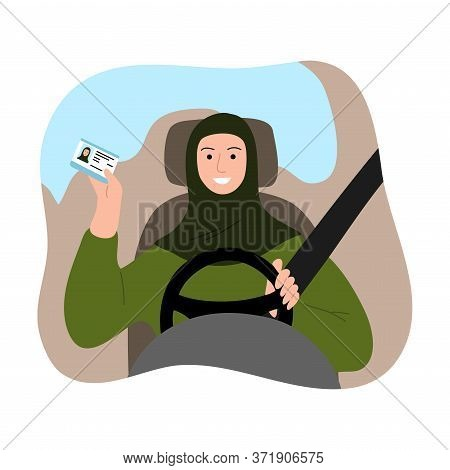 Muslim Arab Woman In Traditional Green Hijab With A Safety Belt Driving A Car And Showing Driving Li