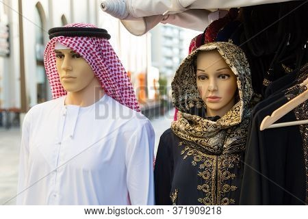 Mannequins In Islamic Clothes On The Street. Male And Female Mannequin In Muslim National Clothes.