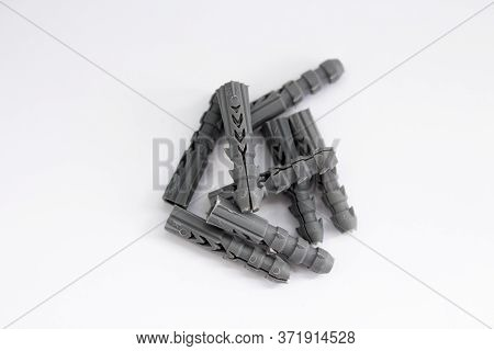 A Grey Dowels On A White Background