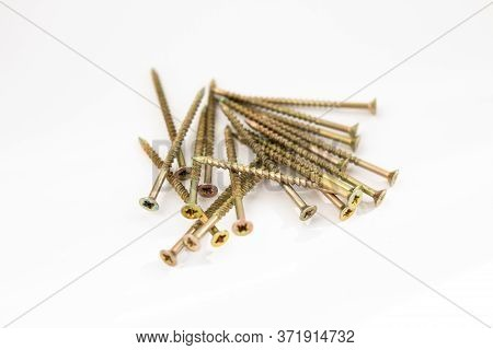 A Metal Dowels On A White Background