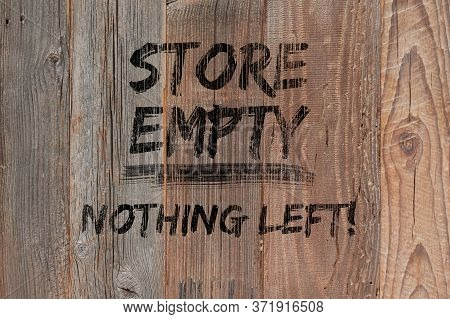 Text Store Empty Nothing Left Painted Black On Wooden Boards. Boutique Shops And Stores Boarded Up.